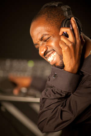 Black young dj working over black background. Stock Photo - 12922134