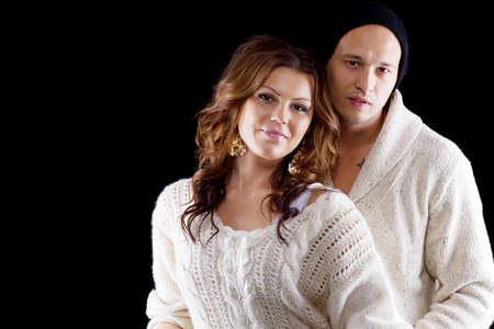 philippino: Young interracial cute looking couple over black background. Stock Photo