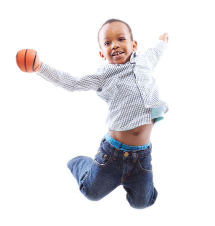 Young happy black boy isolated over a white background jumping in joy. photo