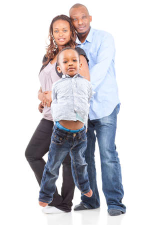 Young cute happy black family - with the son jumping in the front isolated over white background. photo