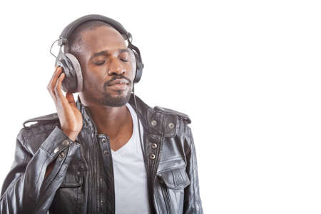 Young man listening to music over his headphones. photo
