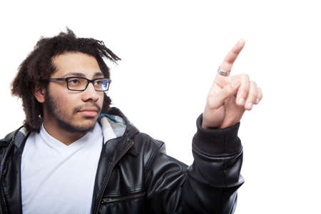 Young man with rasta hair isolated over white pointing with finger. photo