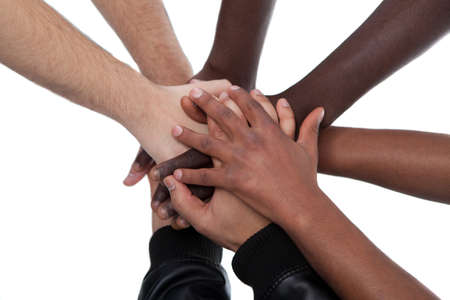 on coming: Many multiracial hands coming together as a team!