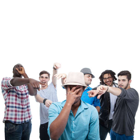 Young group of men who are bullying one of them. Stock Photo - 13215053