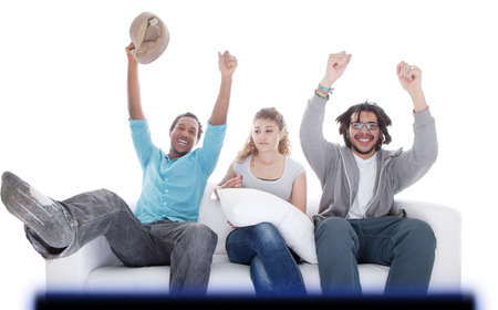 Young teenagers going crazy in front of TV. Isolated over white. photo