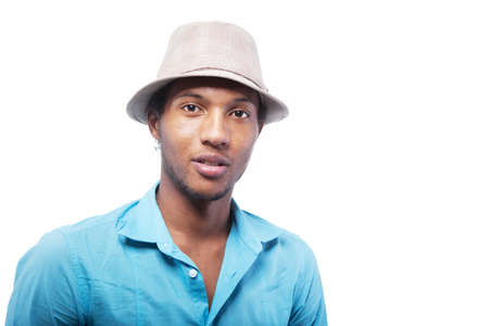 Young brazlian man with a hat isolated over white background. photo