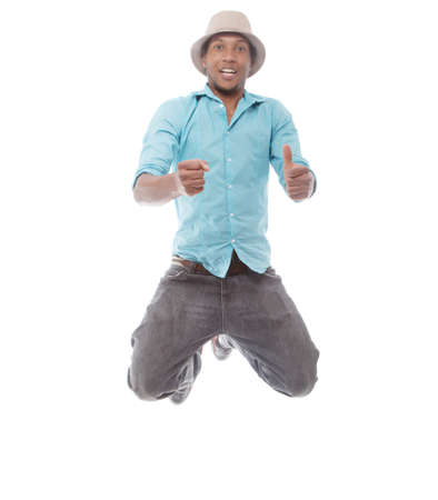 Young afro american man jumping over isolated white background. Stock Photo