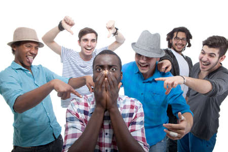 Young group of men who are bullying one of them. photo