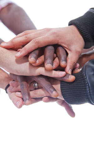 coming together: Many multiracial hands coming together as a team!