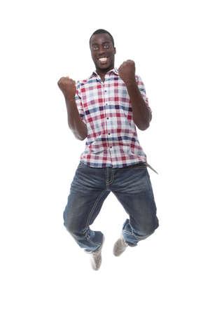 persona saltando: Joven afro americano del hombre saltando sobre fondo blanco.