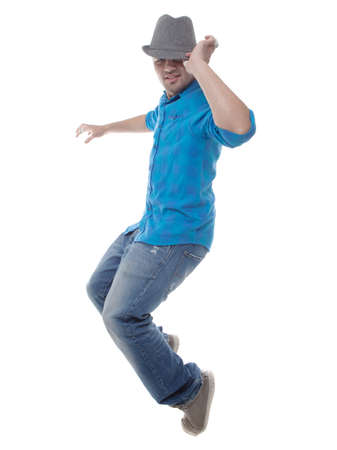 This young man is dancing - isolated over white background. photo