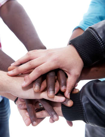 mixed race ethnicity: Many multiracial hands coming together as a team!
