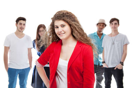 Group of young people with one standing out of the crowd. Focus on the person in front. Stock Photo - 14002719