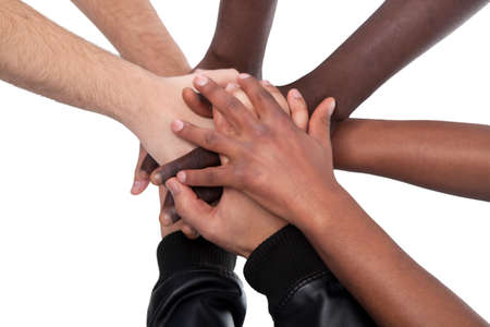 Many Hands Lying On Top Of Each Other On White Background