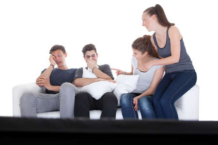 Girls Laughing At Boys While Watching Movie On White Background  photo