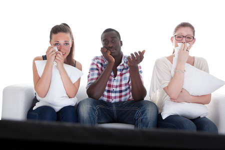 Group Of Friends Watching Emotional Movie On White Background  photo