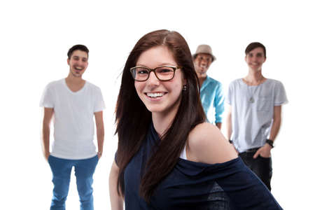 Beautiful Girl Standing In Front Of Boys On White Background photo