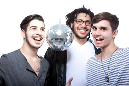 Group Of Happy Friends With Disco Ball Over White Background photo