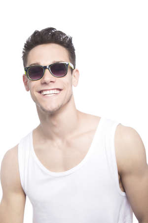 tanktop: Happy Young Man In Tanktop Over White Background Stock Photo
