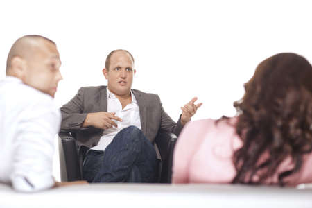 Group Of Businesspeople Discussing Over White Background photo