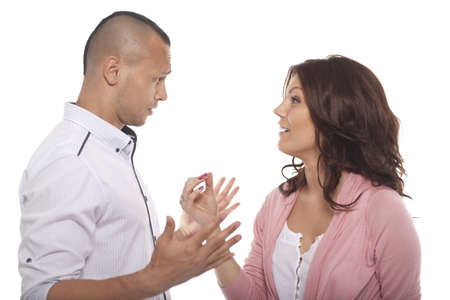 two people talking: Portrait Of A Couple Having A Conversation On White Background