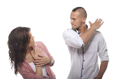 couple arguing: Angry Man Slapping Woman On White Background