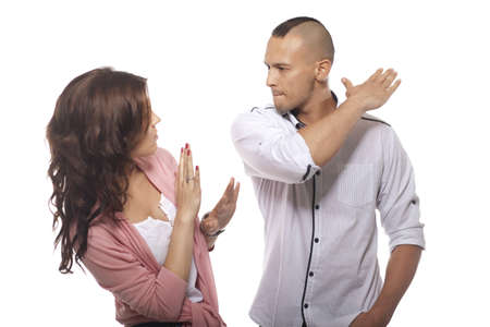 Angry Man Slapping Woman On White Background photo
