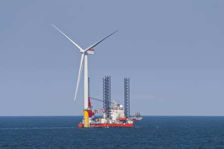 Wind turbine off the Norfolk Coast being constructed by a jack-up vessel Stock Photo - 10008792