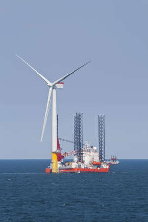 wind energy: Wind turbine off the Norfolk Coast being constructed by a jack-up vessel