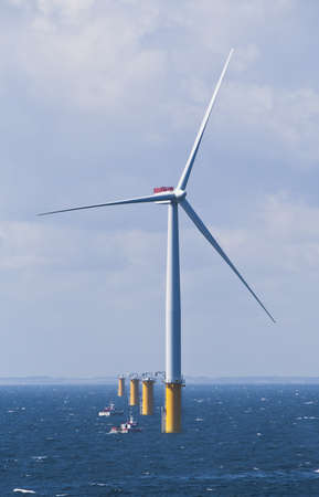 Single Offshore Wind Turbine in a Windfarm under construction  off the English Coast Editorial
