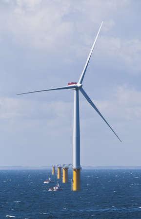 windfarm: Single Offshore Wind Turbine in a Windfarm under construction  off the English Coast Editorial