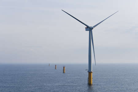 Single Offshore Wind Turbine in a Windfarm under construction  off the English Coast, North Sea