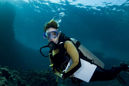 scuba woman: Female scuba diver during an advanced open water course in the Southern Red Sea Stock Photo