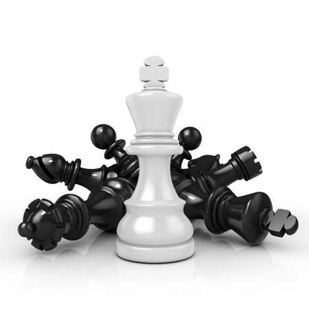 superiority: White king standing over fallen black chess pieces isolated on white background Stock Photo