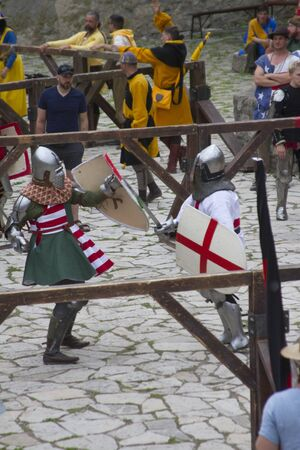battles of knights dressed in medieval armor, buhurt, battle of nations Redakční