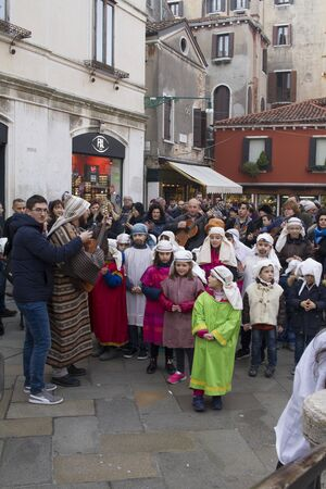 a Christian holiday celebration on the streets of Venice, children dressed in costumes