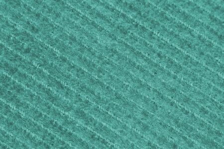 Cyan canvas fabric with a repeating diagonal pattern