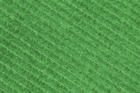 Green canvas fabric with a repeating diagonal pattern Reklamní fotografie