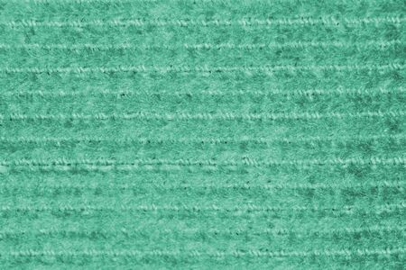 Cyan canvas fabric with a repeating horizontal pattern