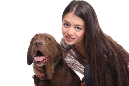 Beautiful asian teen woman with her pet in front of a white background