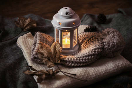 christmas lantern standing on winter wool clothes
