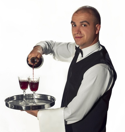 Waiter pouring glasses of wine Stock Photo