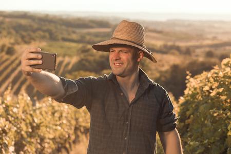 Male farmer in his vineyard making selfie picture