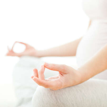 Pregnant woman sitting and meditating