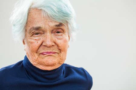 80 plus adult: Portrait of senior woman crying