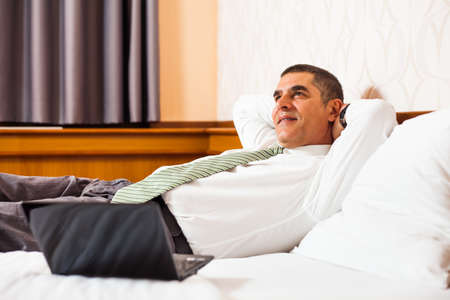 day dreaming: Happy businessman day dreaming Stock Photo