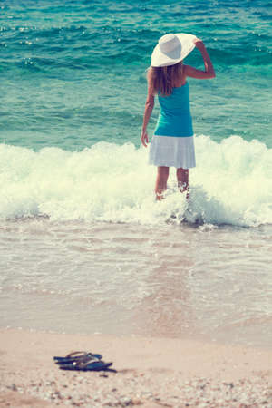 intentionally: Woman standing in sea, intentionally toned Stock Photo