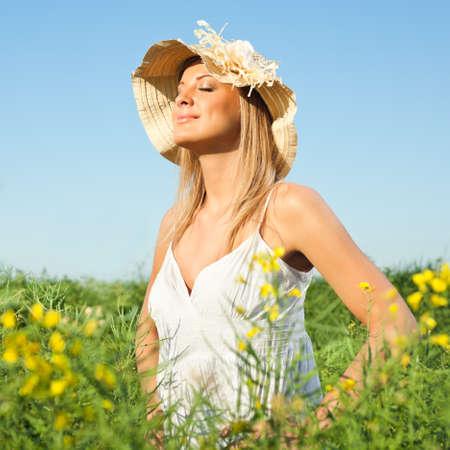 Woman enjoying sun Фото со стока