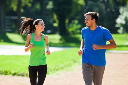 Happy couple jogging outdoor photo