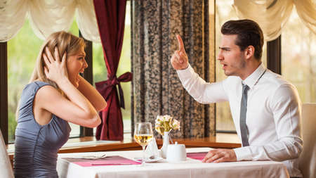 Young couple is arguing in restaurant photo